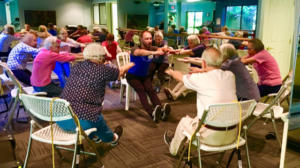 Health & Vitality Wellness class, with The Heritage Downtown residents seated and working out